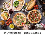big dinner with pizza  salad... | Shutterstock . vector #1051383581