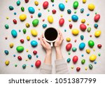 a mug of coffee in a woman's... | Shutterstock . vector #1051387799