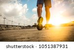 close up feet with running... | Shutterstock . vector #1051387931
