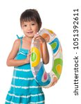 little girl with inflatable... | Shutterstock . vector #1051392611