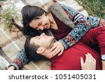 guy and girl on picnic laugh | Shutterstock . vector #1051405031