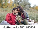 the guy gave the girl flowers | Shutterstock . vector #1051405034