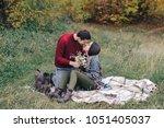 the guy gave the girl flowers | Shutterstock . vector #1051405037