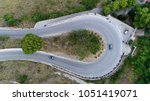 Small photo of Medium altitude aerial photo hairpin turn also called hairpin bend hairpin corner named for its resemblance to hairpin bobby pin is bend in road with a very acute inner angle vehicles driving up
