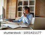 businesswoman in her office.she ... | Shutterstock . vector #1051421177