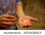 taking medicine pills  | Shutterstock . vector #1051436015