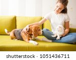 Stock photo young girl with her pets 1051436711