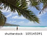 Woman at the famous Anse Lazio, Praslin, Seychelles, Africa - stock photo