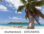 Woman at Anse Takamaka, Praslin, Seychelles, Africa - stock photo
