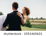 cheerful young bride being... | Shutterstock . vector #1051465631