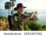 happy man with a black backpack ... | Shutterstock . vector #1051467401