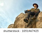 traveler with a black backpack... | Shutterstock . vector #1051467425