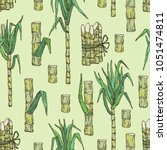 seamless pattern with sugarcane ... | Shutterstock .eps vector #1051474811
