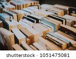 books on sale in a street book... | Shutterstock . vector #1051475081