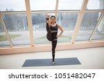 yogi woman in a dark jumpsuit...   Shutterstock . vector #1051482047