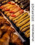 Small photo of Delicious group of french dessert Eclair, colorful eclair.