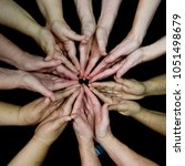 Small photo of Hands of diversity and women's empowerment racial harmony