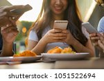 close up on young asian woman... | Shutterstock . vector #1051522694