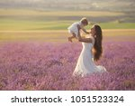 happy mother with little... | Shutterstock . vector #1051523324