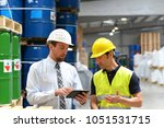 managers and workers in the...   Shutterstock . vector #1051531715