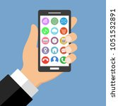 mobile phone in hand with... | Shutterstock . vector #1051532891