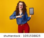 smiling trendy woman with long... | Shutterstock . vector #1051538825