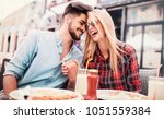 dating in pizzeria. young... | Shutterstock . vector #1051559384