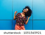 cheerful attractive afro... | Shutterstock . vector #1051565921
