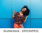 cheerful attractive afro... | Shutterstock . vector #1051565921