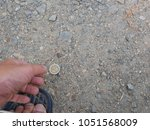 a hand reaching out to pick...   Shutterstock . vector #1051568009