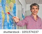 male teacher in the classroom... | Shutterstock . vector #1051574237
