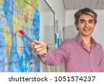 male teacher in the classroom... | Shutterstock . vector #1051574237
