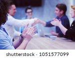 business partner shake hands on ... | Shutterstock . vector #1051577099
