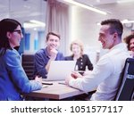 group of a young business... | Shutterstock . vector #1051577117