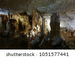 postojna cave  slovenia.... | Shutterstock . vector #1051577441