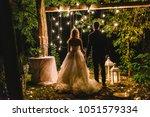 night wedding ceremony with...   Shutterstock . vector #1051579334
