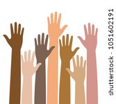 colorful raised hands. the... | Shutterstock .eps vector #1051602191