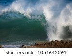foaming white backwash from the ... | Shutterstock . vector #1051642094