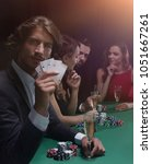 group of sinister poker players | Shutterstock . vector #1051667261