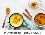 turmeric latte  cooking golden... | Shutterstock . vector #1051673237