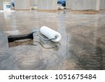 epoxy flooring painting for... | Shutterstock . vector #1051675484