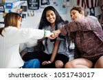 teenage girls in a bedroom fist ... | Shutterstock . vector #1051743017