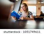 young beautiful student reading ... | Shutterstock . vector #1051749611