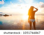 carefree woman running in the... | Shutterstock . vector #1051766867