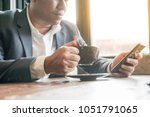 business man  freelancer using... | Shutterstock . vector #1051791065