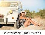 girl enjoying music near a...   Shutterstock . vector #1051797551
