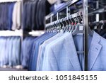 rack with suit jackets in... | Shutterstock . vector #1051845155