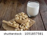 fresh macadamia nut with glass... | Shutterstock . vector #1051857581