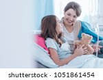 sisters smiling and lying in... | Shutterstock . vector #1051861454