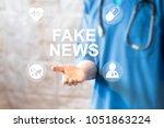 doctor pressing button fake... | Shutterstock . vector #1051863224